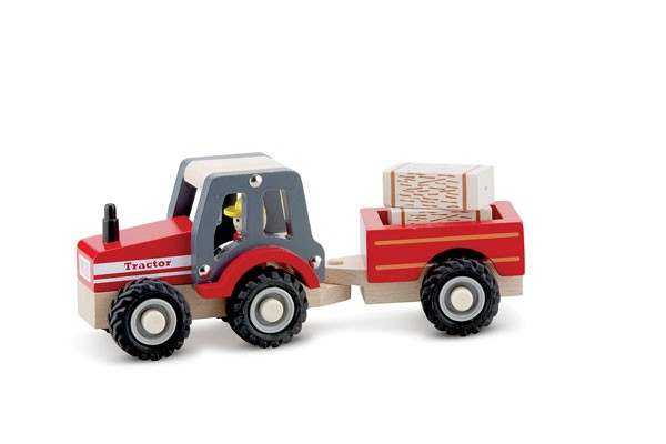 Traktor mit Anhänger und Heuballen