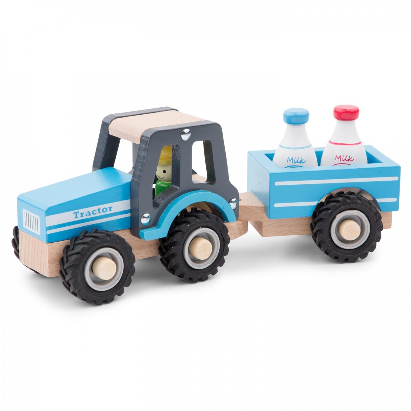 Traktor mit Anhänger und Milchkannen